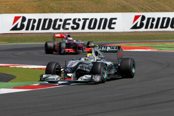 Silverstone, Northamptonshire, England11th July 2010Nico Rosberg, Mercedes GP W01, 3rd position, leads Jenson Button, McLaren MP4-25 Mercedes, 4th position. Action. World Copyright: Andrew Ferraro/LAT Photographicref: Digital Image _Q0C8992