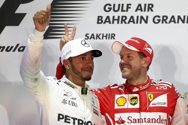 Bahrain International Circuit, Sakhir, Bahrain.  Sunday 16 April 2017. Lewis Hamilton, Mercedes AMG, 2nd Position, and Sebastian Vettel, Ferrari, 1st Position, on the podium. World Copyright: Steve Etherington/LAT Images ref: Digital Image SNE23077