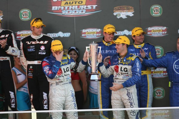 V8 Supercar Championship Round 9 Bathurst. Race winners Craig Lowndes and Jamie Whincup (Team Betta Electrical Ford Falcon BA) hold the Peter Brock Trophy on the podium at the Supercheap Auto 1000 at Mt Panorama, Bathurst. Australia. October 5th - 8th, 2006. Mark Horsburgh