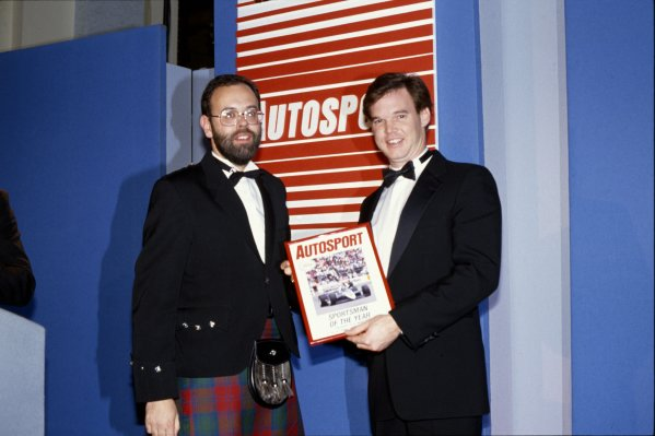 1989 Autosport Awards.Cafe Royal, London, Great Britain. 4 January 1990.Al Unser jr receives the Sportsman of the Year Award from Peter Foubister.World Copyright: LAT PhotographicRef: 35mm transparency