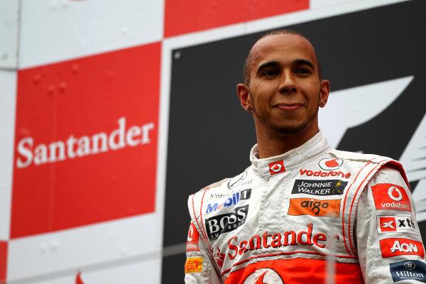 Nurburgring, Germany.24th July 2011Lewis Hamilton, McLaren MP4-26 Mercedes, 1st position, on the podium. Portrait. Podium. World Copyright: Andy Hone/LAT Photographicref: Digital Image CSP13423