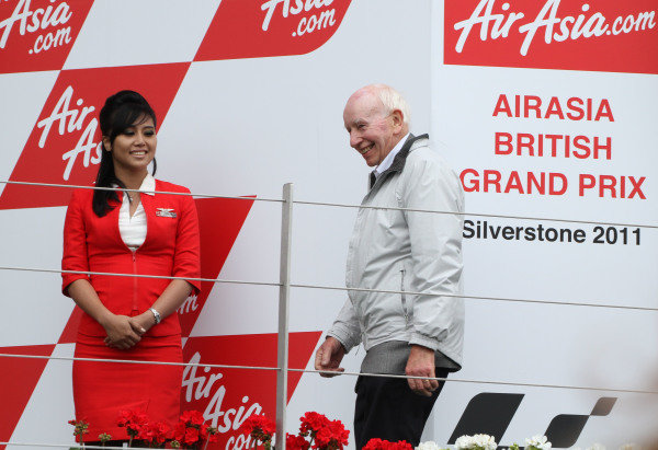 British Grand Prix. Silverstone, England. 10th-12th June 2011. John Surtees is welcomed onto the podium to present the winner's trophy. World Copyright: Kevin Wood/LAT Photographic. ref: Digital Image