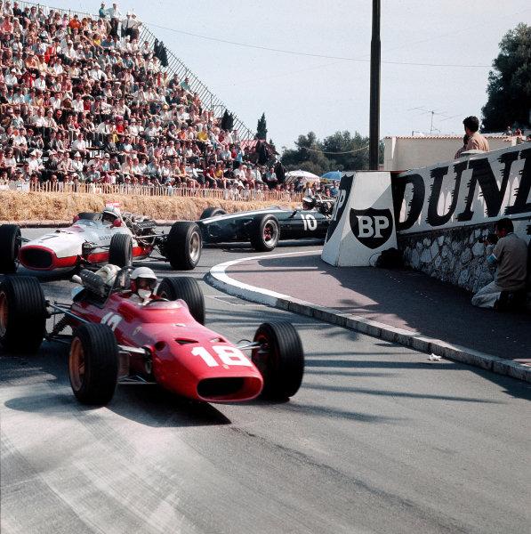 Monte Carlo, Monaco.4-7 May 1967.Lorenzo Bandini (Ferrari 312) leads John Surtees (Honda RA273) and Jochen Rindt (Cooper T81B Maserati). Bandini later crashed suffering fatal injuries.Ref-3/2807.World Copyright - LAT Photographic