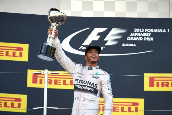 Suzuka Circuit, Suzuka, Japan.  Sunday 27 September 2015. Lewis Hamilton, Mercedes AMG, 1st Position, lifts his trophy. World Copyright: Steve Etherington/LAT Photographic ref: Digital Image SNE29072