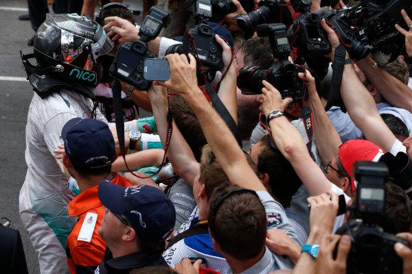 Monte Carlo, Monaco. Sunday 25 May 2014. Nico Rosberg, Mercedes AMG, 1st Position, celebrates on arrival in Parc Ferme. World Copyright: Glenn Dunbar/LAT Photographic. ref: Digital Image _89P0445