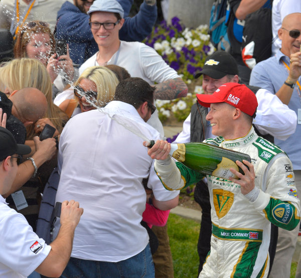 "11-13 April, 2014, Long Beach, California USA #20 Mike Conway Fuzzy""s Vodka/ Ed Carpenter Racing, race winner with champagne ©2014, Dan R. Boyd Lat Photo USA"