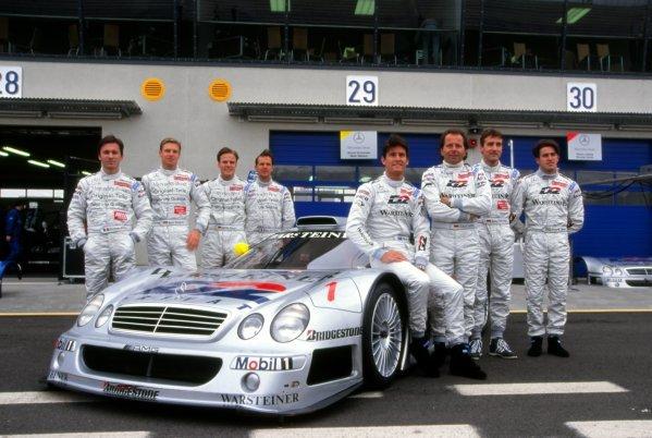 L-R: Christophe Bouchet (FRA); Bernd Maylander (GER); Marcel Tiemann (GER); Jean-Marc Gounoun (FRA); Mark Webber (AUS); Klaus Ludwig (GER); Bernd Schneider (GER); Ricardo Zonta (BRA) with the Mercedes-Benz CLK-GTR. FIA Grand Touring Championship, Rd1, Oschersleben, Germany, 12 April 1998.