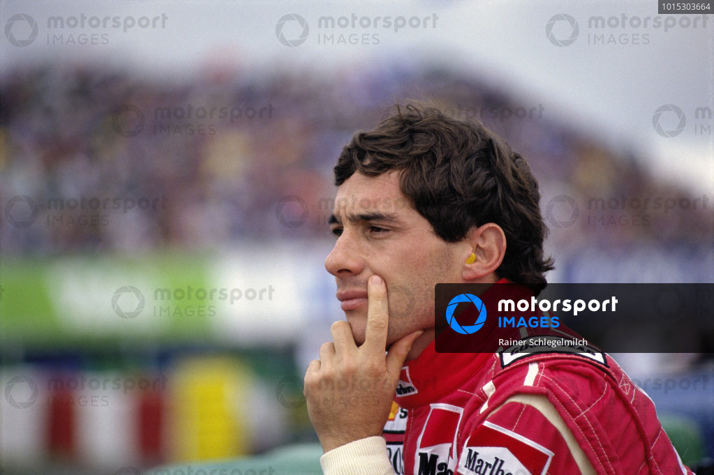 Ayrton Senna watches after retiring on the first lap due to contact from Michael Schumacher's Benetton.