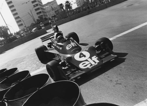 Long Beach, California, USA. 26th - 28th March 1976. Patrick Depallier (Tyrrell 007-Ford), 3rd position, action.  World Copyright: LAT Photographic.  Ref:  8415 - 7.