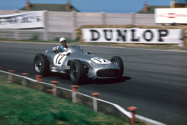 Aintree, Great Britain. 16th July 1955.Stirling Moss (Mercedes Benz W196), 1st position position, action.World Copyright: LAT PhotographicRef: 55GB11.