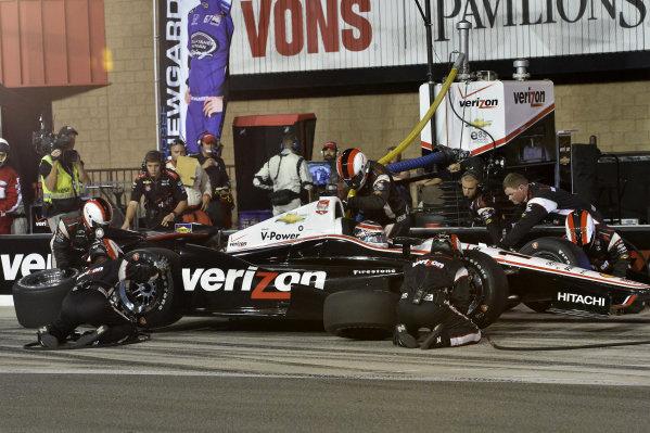 Will Power (AUS) Team Penske, makes a pit stop.Verizon IndyCar Series, Rd18, MAVTV 500, Auto Club Speedway, Fontana, USA, 29-30 August 2014.