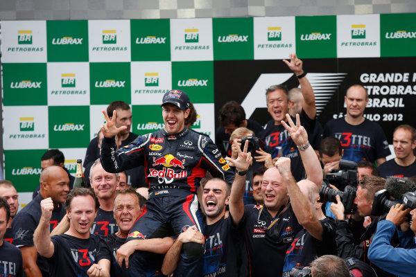 Interlagos, Sao Paulo, Brazil. Sunday 25th November 2012. 2012 World Champion Sebastian Vettel, Red Bull RB8 Renault, celebrates with the Red Bull team. World Copyright:Charles Coates/LAT Photographic ref: Digital Image _N7T8287