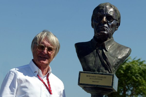 """Bernie Ecclestone (GBR) F1 Supremo with a bronze bust of himself in the new Hungaroring """"Park of Dignitaries"""". Sculptures were created by Hungarian artist Gabor Mihaly (HUN). Formula One World Championship, Rd13, Hungarian Grand Prix, Hungaroring, Hungary, 23 August 2003. DIGITAL IMAGE"""