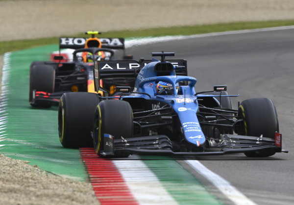Fernando Alonso, Alpine A521, leads Sergio Perez, Red Bull Racing RB16B