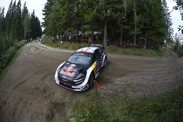 Sebastien Ogier sliding his Ford Fiesta WRC around a tight corner on Rally Finland