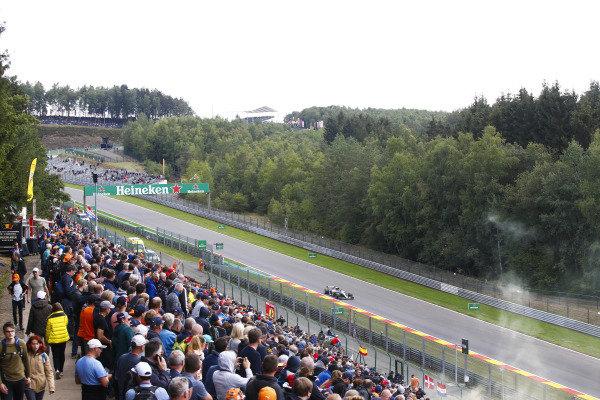Lewis Hamilton, Mercedes AMG F1 W09, passes a bank of spectators.