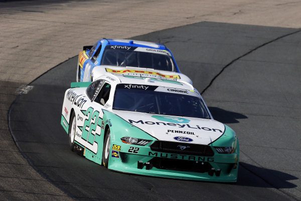 #22: Austin Cindric, Team Penske, Ford Mustang MoneyLion and #08: Gray Gaulding, SS Green Light Racing, Chevrolet Camaro