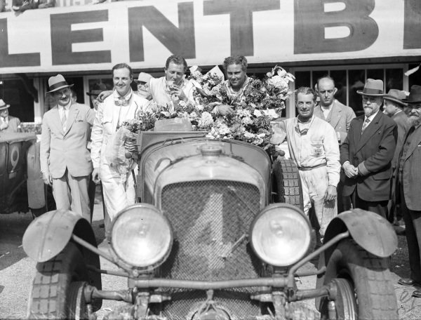 Woolf Barnato / Glen Kidston, Team Bentley, Bentley Speed Six. The drivers of the second-placed Bentley stand next to the winning car, Dick Watney (left) and Frank Clement (right).