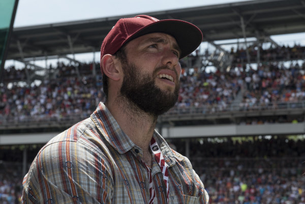 Indianapolis Colts Quarterback Andrew Luck watch the race