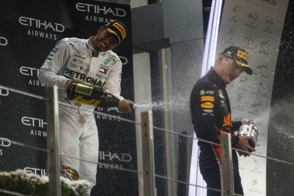 Lewis Hamilton, Mercedes AMG F1, 1st position, andMax Verstappen, Red Bull Racing, 2nd position, spray Champagne on the podium