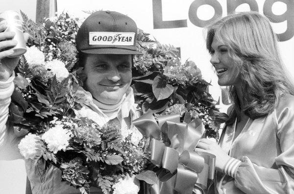 Alan Jones (AUS) Williams, celebrates his third position on the podium.United States Grand Prix West, Rd 4, Long Beach, California, USA, 8 April 1979.