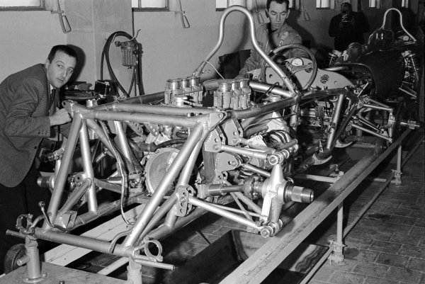 Tubular spaceframe, with engine and suspension attached to a Ferrari 156 being assembled at the Ferrari factory. Ferrari F1 Garage, Maranello, Italy, 1962.