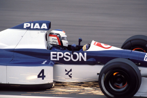 Jean Alesi, Tyrrell 019 Ford, with sparks flying and brake discs glowing.