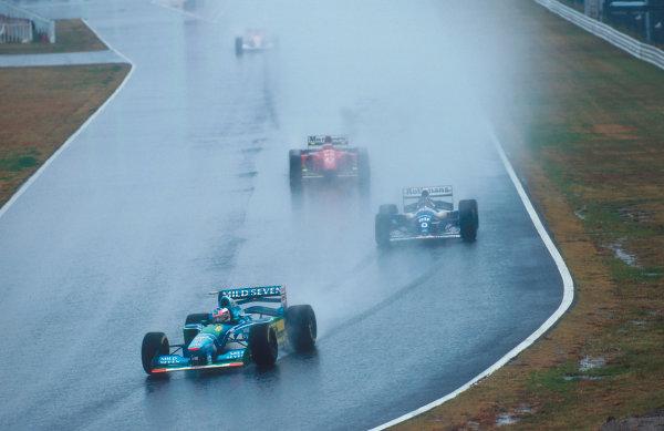 Suzuka, Japan. 4th - 6th November 1994. Michael Schumacher (Benetton B194 Ford) leads Damon Hill (Williams FW16B Renault) and Jean Alesi (Ferrari 412T1B).Ref-94 JAP 04.World Copyright - LAT Photographic