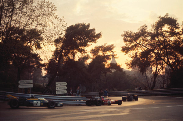 1971 Spanish Grand Prix. Montjuich Park, Barcelona, Spain.16-18 April 1971.Ronnie Peterson (March 711 Ford) and Graham Hill (Brabham BT34 Ford) race in the fading light.A Race Through Time exhibition number 108.World Copyright - LAT Photographic