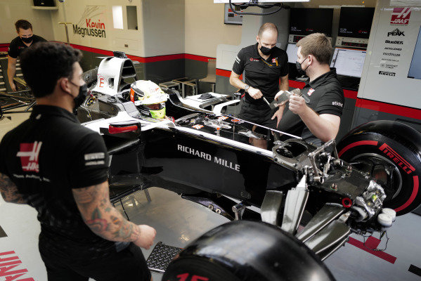 Mick Schumacher sits in his Haas VF-20 for his seat fitting with race engineer Gary Gannon.