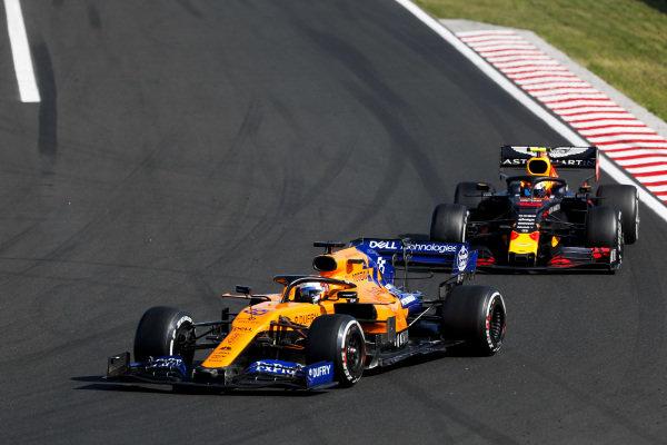 Carlos Sainz Jr., McLaren MCL34, leads Pierre Gasly, Red Bull Racing RB15