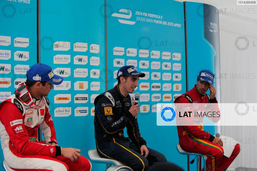 2014 FIA Formula E Championship. Punta del Este ePrix, Uruguay. Post-race press conference. Sebastien Buemi (SWI)/E.dams Renault - Spark-Renault SRT_01E (first position), Nelson Piquet Jr (BRA)/China Racing - Spark-Renault SRT_01E (second position) and Lucas di Grassi (BRA)/Audi Abt Sport - Spark-Renault SRT_01E (third position). Photo: Zak Mauger/LAT/FE ref: Digital Image _MG_0124