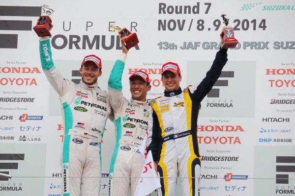 2014 Super Formula Series. Suzuka, Japan. 9th - 10th November 2014. Rd 7. Race 2 - Winner Kazuki Nakajima ( #37 TEAM TOM'S SF14 )  2nd position Andre Lotterer ( #36 PETRONAS TOM'S SF14 ) 3rd position Loic Duval ( #8 Team KYGNUS SUNOCO SF14 ) podium, portrait. World Copyright: Yasushi Ishihara / LAT Photographic. Ref:  2014_SF_Rd7_021.JPG