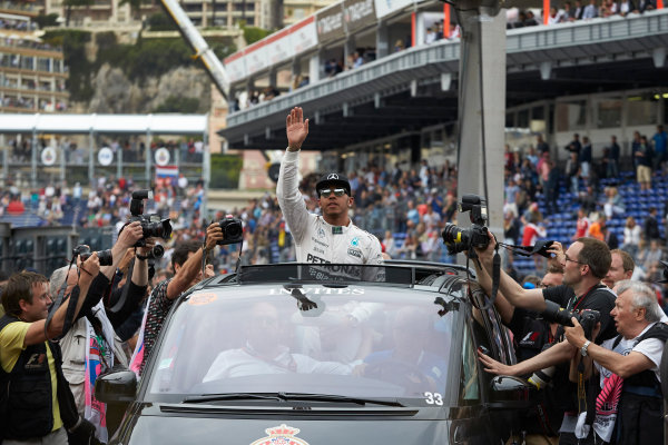 Monte Carlo, Monaco. Saturday 23 May 2015. Pole starter Lewis Hamilton, Mercedes AMG, is driven away from Parc Ferme after qualifying. World Copyright: Steve Etherington/LAT Photographic. ref: Digital Image SNE26587