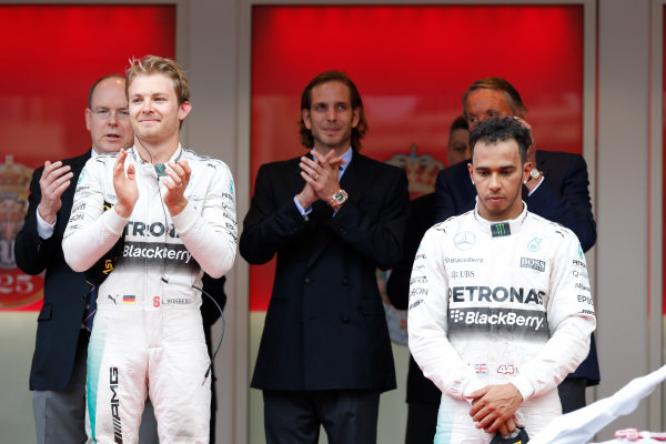 Monte Carlo, Monaco. Sunday 24 May 2015. Nico Rosberg, Mercedes AMG, 1st Position, and a dejected looking Lewis Hamilton, Mercedes AMG, 3rd Position, on the podium. World Copyright: Steven Tee/LAT Photographic. ref: Digital Image _L4R3236