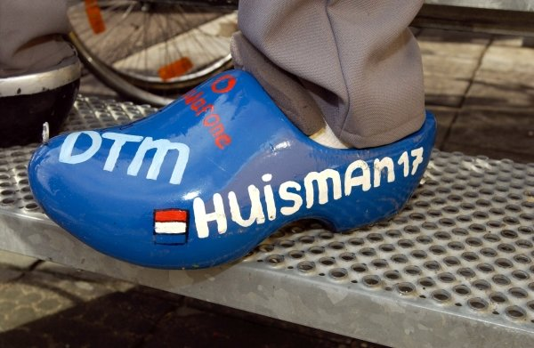 Fans of Dutchman Patrick Huisman (NED), Eschmann AMG Mercedes, wear clogs painted in the colours of Patrick's car.DTM Championship, Rd9, Zandvoort, Holland. 29 September 2002.DIGITAL IMAGE