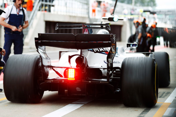 Silverstone, Northamptonshire, UK.  Friday 14 July 2017. Lance Stroll, Williams FW40 Mercedes, spins his wheels exiting his pit box. World Copyright: Glenn Dunbar/LAT Images  ref: Digital Image _31I2815