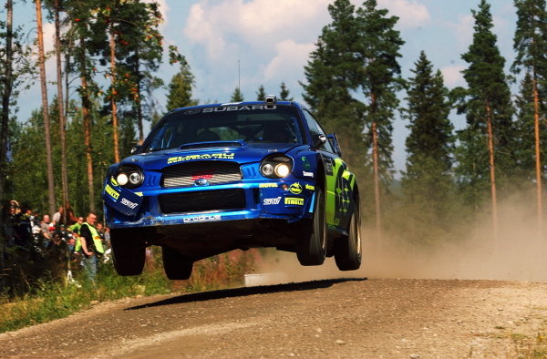 Petter Solberg (NOR) leaps his Subaru Impreza WRC on his way to a third place finish.