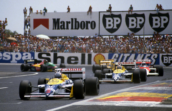Nigel Mansell (GBR) Williams FW11B leads team mate Nelson Piquet (BRA) Williams Honda FW11B and Alain Prost (FRA) McLaren TAG MP4/3. Formula One World Championship, Rd 6, French Grand Prix, Paul Ricard, France, 5 July 1987.