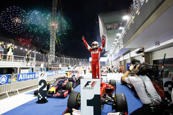 Marina Bay Circuit, Singapore. Sunday 20 September 2015. Sebastian Vettel, Ferrari, 1st Position, celebrates on arrival in Parc Ferme. World Copyright: Steven Tee/LAT Photographic ref: Digital Image _L4R1826