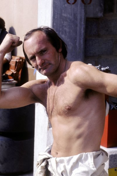 Mike Hailwood (GBR), McLaren, shows off his muscles to the camera in his final season as a Grand Prix driver.