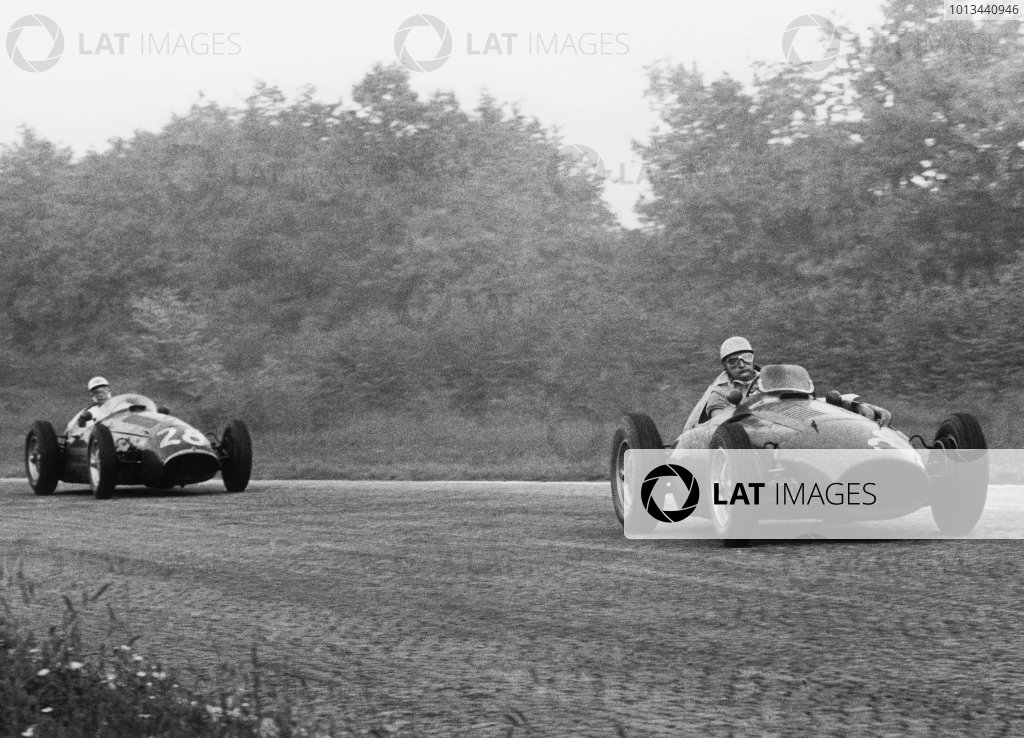 Monza, Italy. 5th September 1954.Jose Froilan Gonzalez (Ferrari 555), retired, leads Stirling Moss (Maserati 250F), 10th position, action. World Copyright: LAT Photographic .