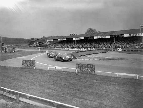1958 Sussex Trophy. Goodwood, Sussex, Great Britain. Easter Monday, 7th April 1958. Stirling Moss (Aston Martin DBR2), 1st position leads Archie Scott-Brown (Lister - Jaguar), DNF, action.  World Copyright: LAT Photographic.  Ref:  Autocar Glass Plate C51023.
