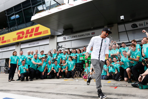 Red Bull Ring, Spielberg, Austria. Sunday 21 June 2015. Nico Rosberg, Mercedes AMG, 1st Position, and Lewis Hamilton, Mercedes AMG, 2nd Position, celebrate with their team. World Copyright: Alastair Staley/LAT Photographic. ref: Digital Image _R6T7251
