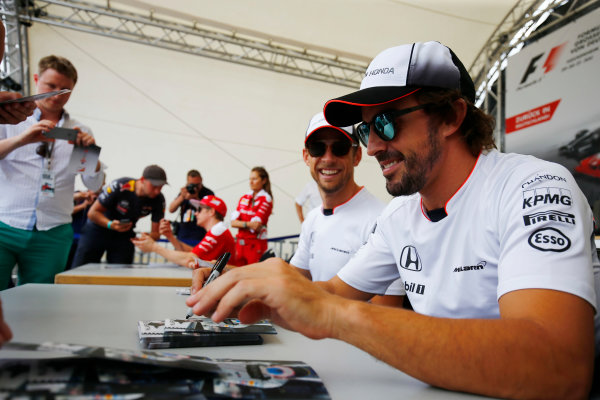 Hockenheim, Germany. Saturday 30 July 2016. Fernando Alonso, McLaren, and Jenson Button, McLaren, signs autographs for fans.  World Copyright: Andy Hone/LAT Photographic ref: Digital Image _ONZ7564