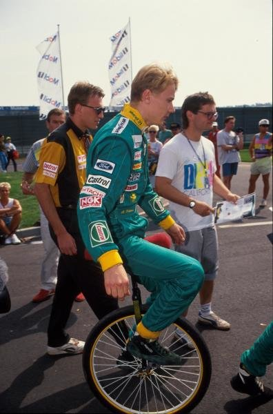 Mika Hakkinen (FIN) demonstrates admirable circus skills on his unicycle.  