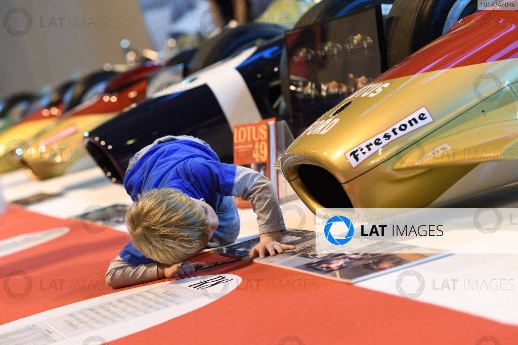 Autosport International Exhibition. National Exhibition Centre, Birmingham, UK. A young fans examines the front of a Gold Leaf Lotus 49 at close quarters. World Copyright: Sam Bagnall/LAT Images Ref: DSC_5853