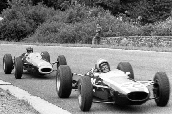 1964 Belgian Grand Prix.Spa-Francorchamps, Belgium. 14 June 1964.Bruce McLaren, Cooper T73-Climax, 2nd position, leads Graham Hill, BRM P261, 5th position, action.World Copyright: LAT Photographic