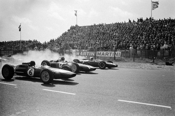 Jim Clark, Lotus 25 Climax, Graham Hill, BRM P57 and Bruce McLaren, Cooper T66 Climax, blast away from the front row of the grid at the start.