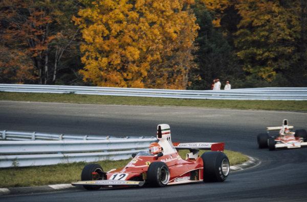 Niki Lauda, Ferrari 312T leads Emerson Fittipaldi, McLaren M23 Ford.